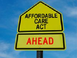 Affordable Care Act yellow caution sign
