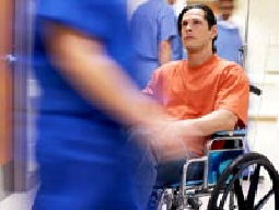 Man in wheelchair in hospital