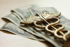 Medical Symbol and dollar bills