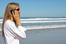 woman on phone at beach